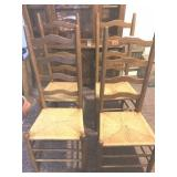 4 ladder back woven bottom chairs ( one has small