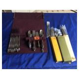 Two sets of 8 place flatware