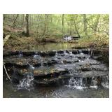 105 Acres with a creek and beautiful water falls!!
