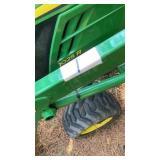 John Deere 1025 R, with front end loader & backhoe