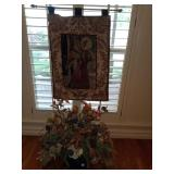 Angel wall hanging and a floral centerpiece