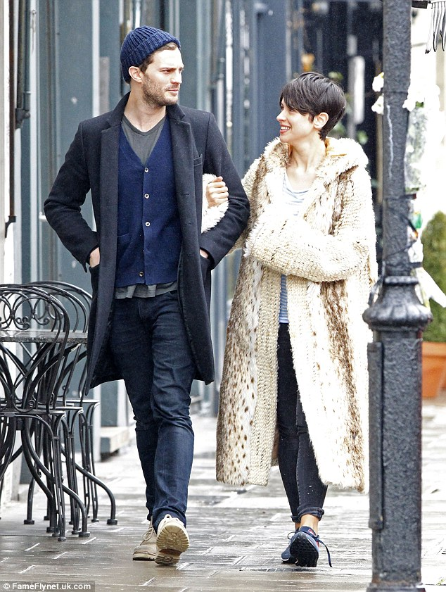 2613550000000578-2968492-No_wonder_she_s_smiling_Jamie_Dornan_stepped_out_with_his_wife_A-m-61_1424877323338