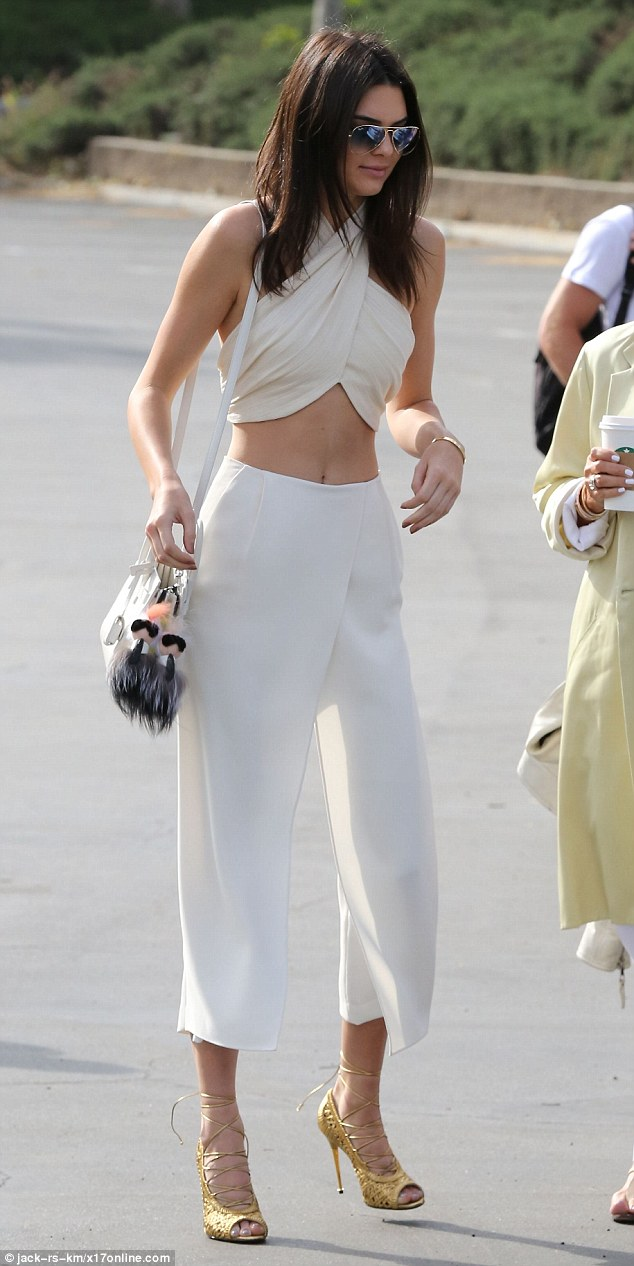 274E6A4F00000578-3026860-Is_that_really_suitable_for_Easter_mass_Kendall_Jenner_was_certa-m-16_1428274241296