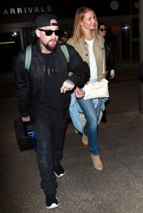 Cameron-Diaz-and-Benji-Madden-arriving-on-a-flight-at-LAX-airport-in-Los-Angeles-CA