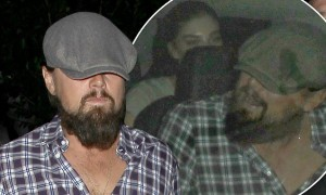 """UK CLIENTS MUST CREDIT: AKM-GSI ONLY EXCLUSIVE: SHOT ON 10/03/14 West Hollywood, CA - Acclaimed actor Leonardo DiCaprio  keeps his newsboy cap pulled low as he makes his way back to his vehicle after the """"Kings of Leon"""" after party at Warwick Nightclub.  The handsome actor, who is currently dating model Toni Garnn, hopped in a vehicle as two mystery women followed and sat in the backseat.  Pictured: Leonardo DiCaprio Ref: SPL858005  041014   EXCLUSIVE Picture by: AKM-GSI"""