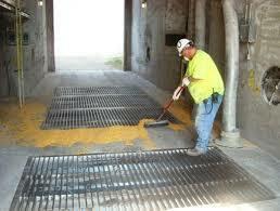man-sweeping-grain-at-dump-pit.jpeg#asset:209456