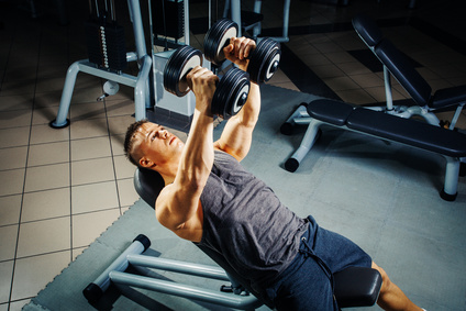Man Performing Incline Dumbbell Flyes