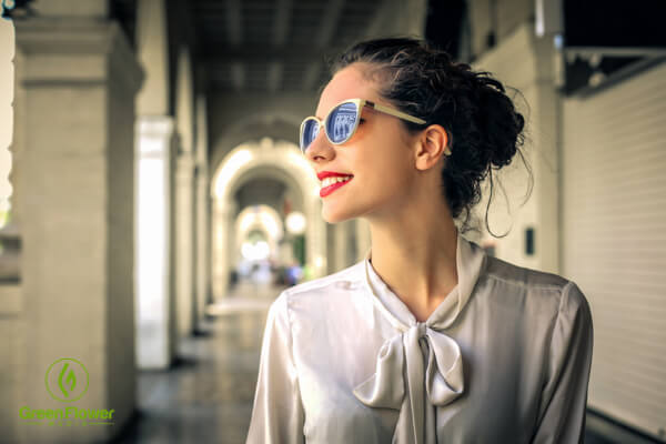 woman with sunglasses, smiling