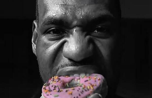 Lebron James eating a doughnut