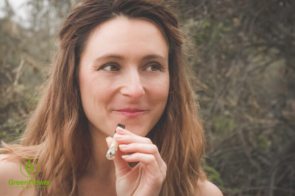 Mandee smokes cannabis from the one-hitter.