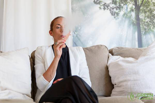Woman vaping cannabis