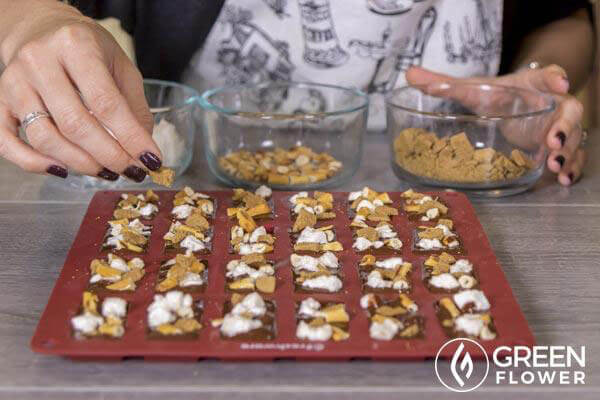 Mandee preparing cannabis chocolate pretzel smore bars.