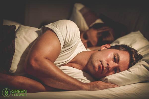 man wide-awake with insomnia
