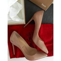 Louboutin pigalles in nude color