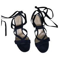 Black Sandals by Gianvito Rossi.