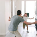 Starter family son running to dad as he's excited to come home