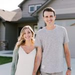 Couple in front of their brand new home in Sisters