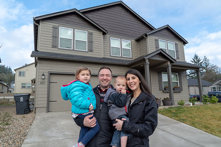 2018 Hayden Homes Backyard Giveaway Winners in front of their house