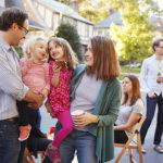 Tips for Meeting Your New Neighbors - Parents holding their young kids