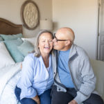 Older couple on their bed in their Hayden Home