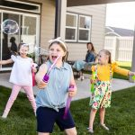 kids play in their backyard of their new Hayden Home