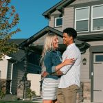 Young couple in front of their new Hayden Home