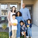 Family in front of their new Hayden Home