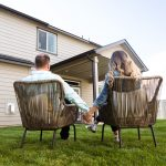 Young Couple sitting in front of their new Hayden Home
