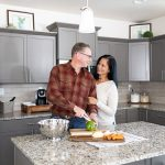 Couple cooking dinner in their new home kitchen