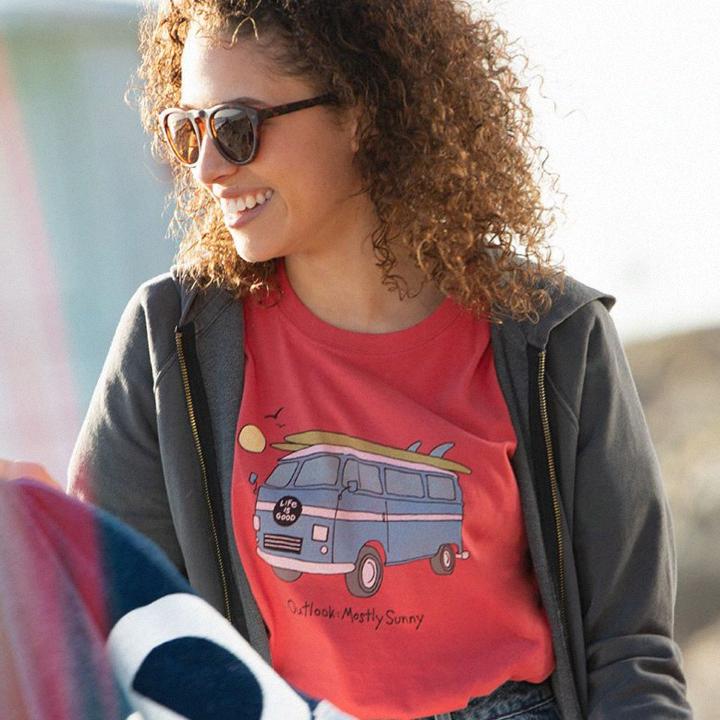Woman wearing sunglasses and Life is Good tee shirt