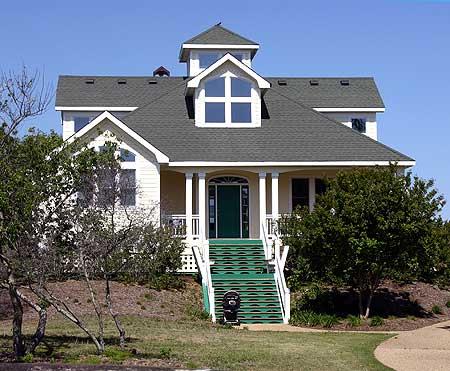 Raised beach cottage 13057fl architectural designs for Raised beach house plans