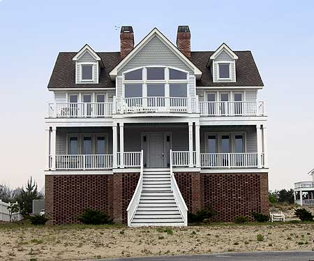 13074fl beach cottage shingle vacation narrow lot for Beach house plans with garage underneath