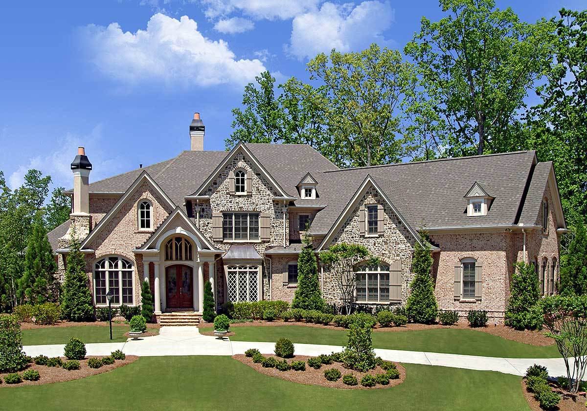 4-Bed Luxury House Plan With Angled Garage And Family Room