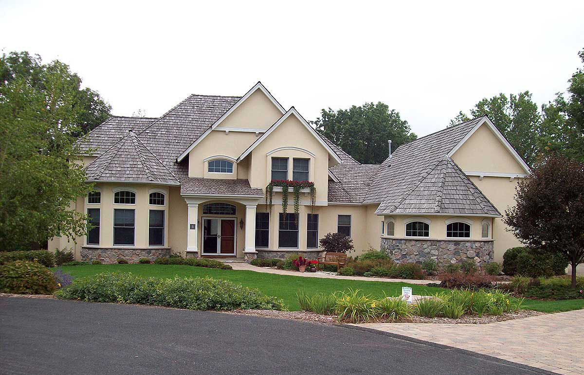 Built for entertaining 20084ga architectural designs for Large home plans for entertaining