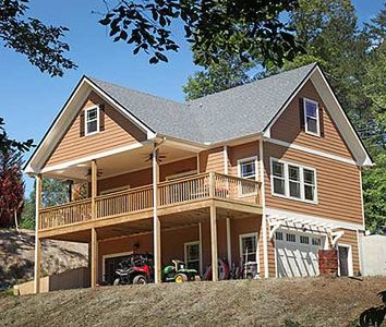 Vacation cottage with drive under garage 24114bg for Vacation cabin plans