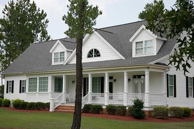 three bedroom house plan with porches in front and back