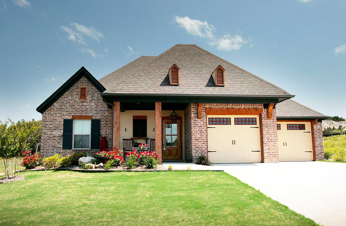 Acadian house plan with unique garage layout 915018chp for Unique garage plans