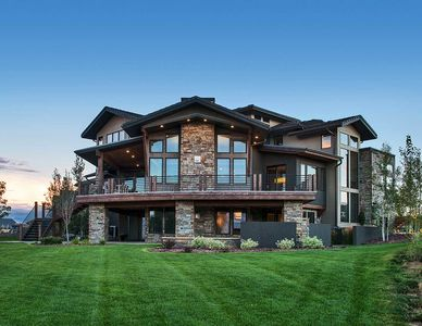 Unique Craftsman House Plan with Sunken Great Room - 95031RW thumb - 02