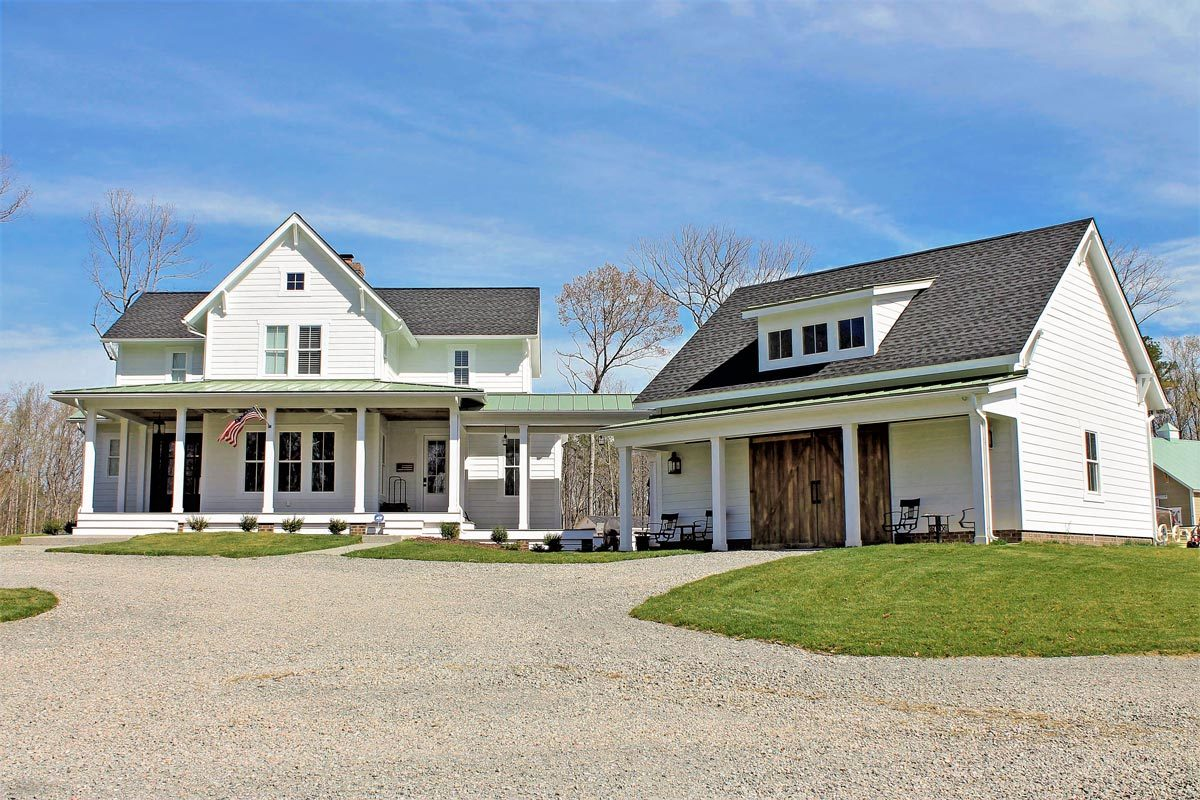 Quintessential american farmhouse with detached garage and for Farmhouse style building plans