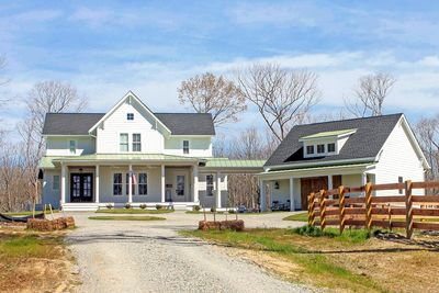 Quintessential American Farmhouse with Detached Garage and Breezeway