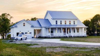 Modern farmhouse plan with wrap around porch and breezeway for Farmhouse house plans with wrap around porch