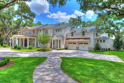 Palatial traditional home plan with fabulous master suite for Moderate house plans