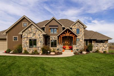 Gorgeous craftsman house plan with mother in law suite for Craftsman house plans with mother in law suite