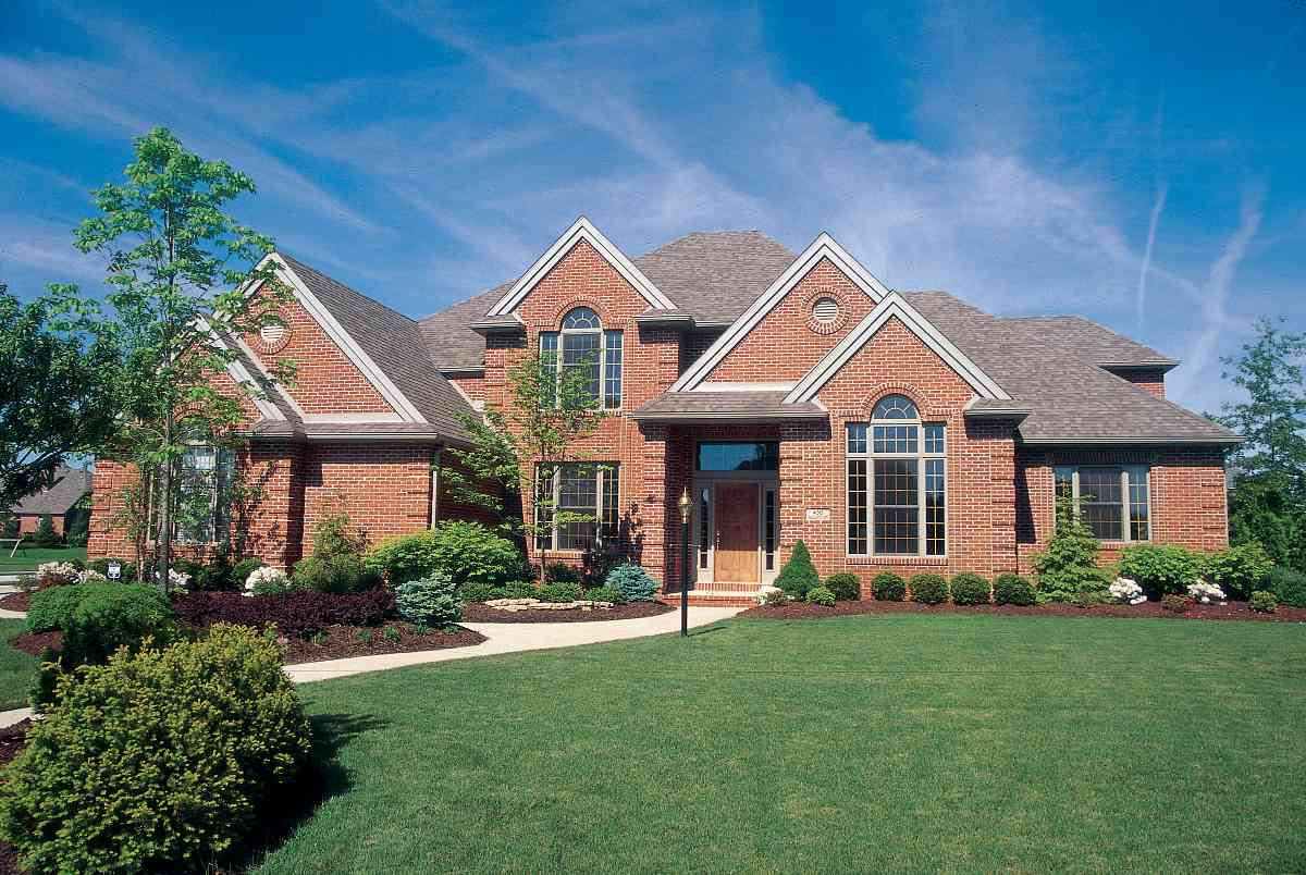 Dignified traditional brick home 41124db architectural for Traditional brick house plans