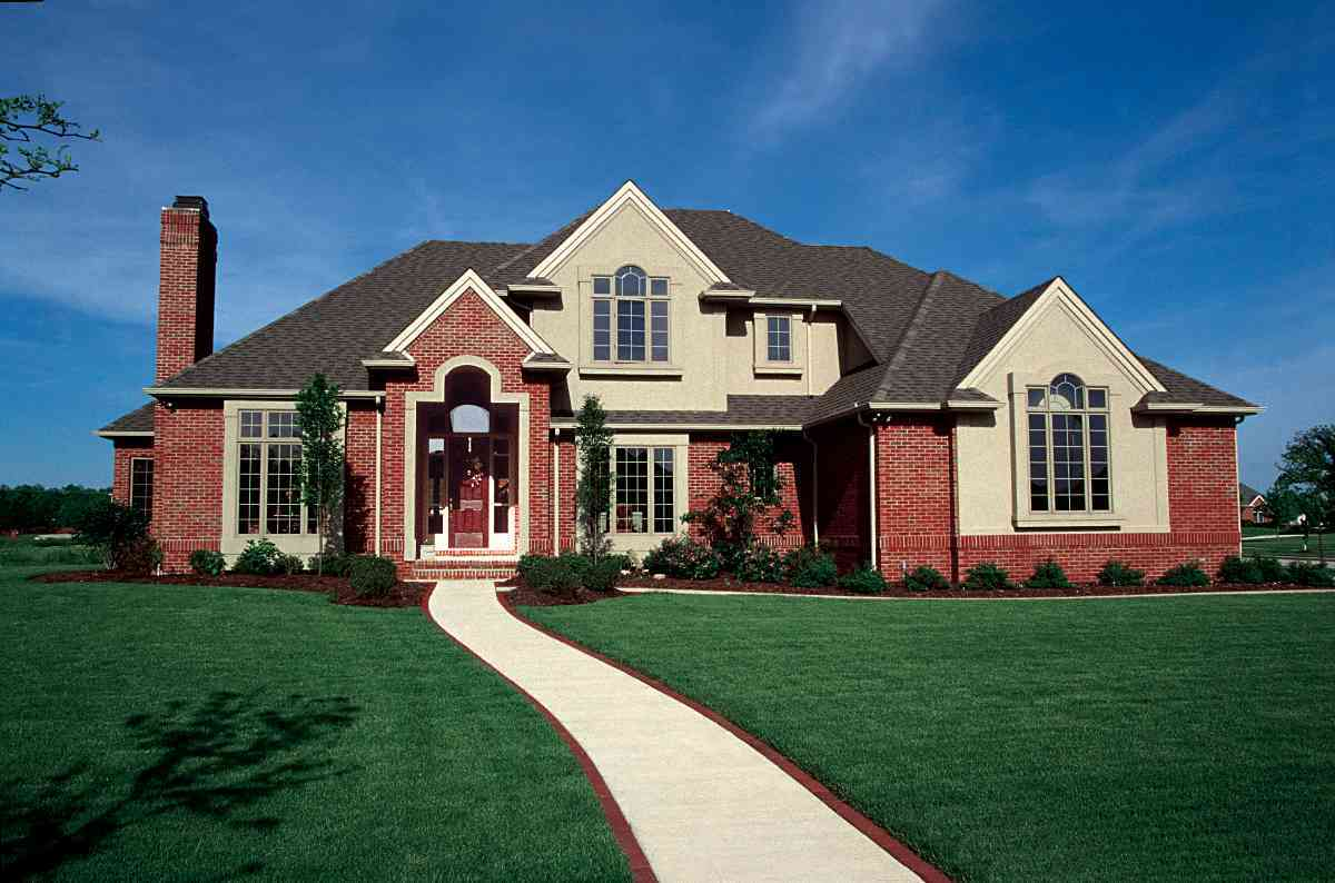Interplay of brick and stucco 4160db architectural for Stucco home plans