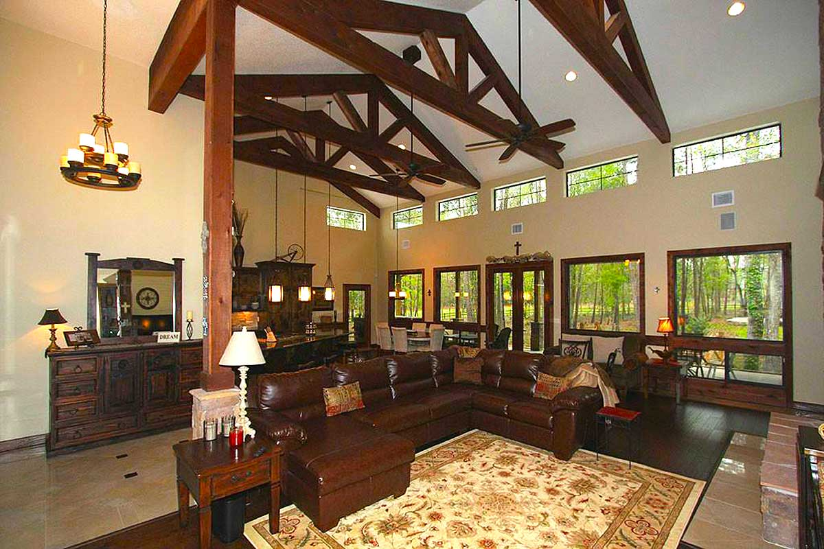 Hill country home with massive porch 46052hc 1st floor for Country home collections flooring