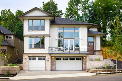 for a front-sloping lot - 6924am | architectural designs - house plans