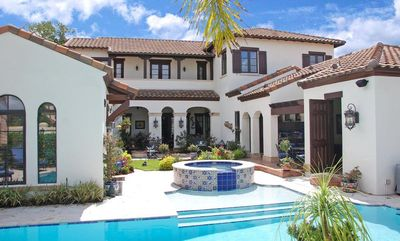 Spanish colonial with central courtyard 82009ka for Spanish home plans center courtyard pool