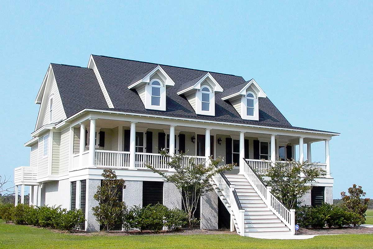 Raised low country classic with elevator 9143gu 1st for Raised house plans with garage underneath