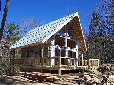 Vacation escape with loft and sundeck 9836sw for Vacation cabin plans